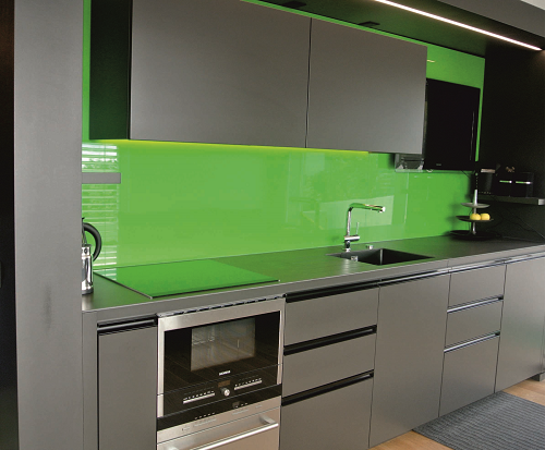 Kitchen design by IG Kitchens with green panels